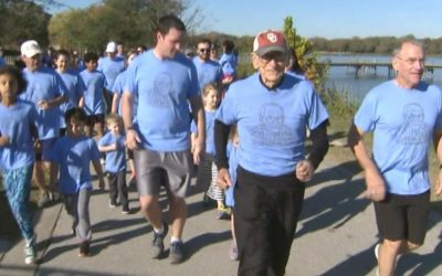 WWII veteran celebrates 100th birthday by running 100 miles with his family